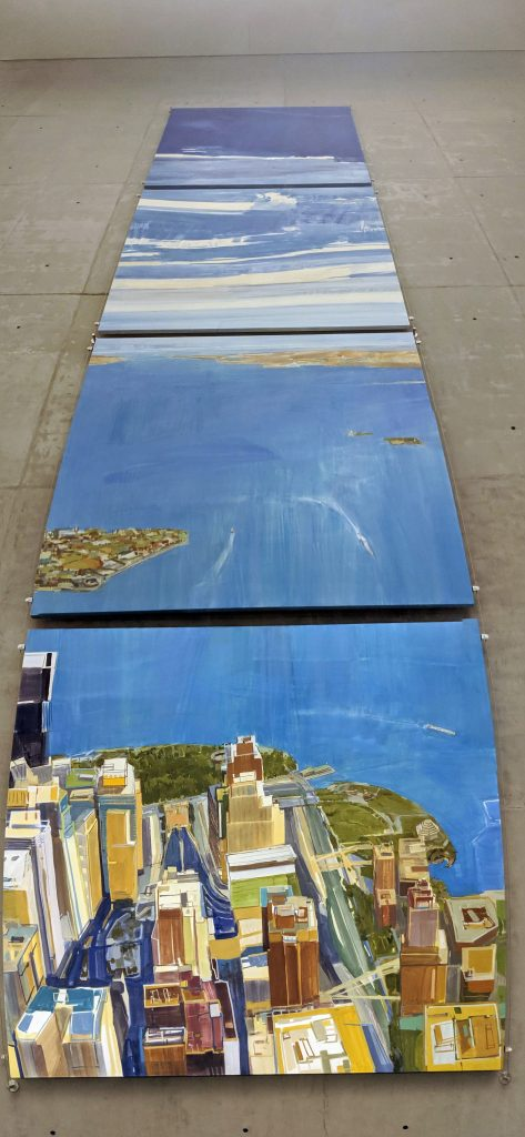Four large paintings arranged vertically to represent the view one would see when looking out the window of one of the towers.
